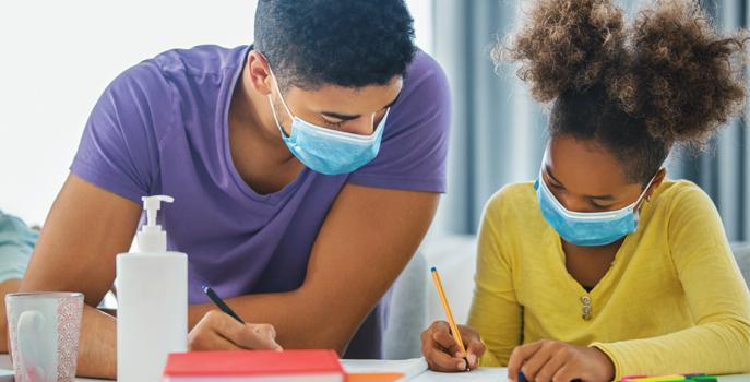 Tutor helping student